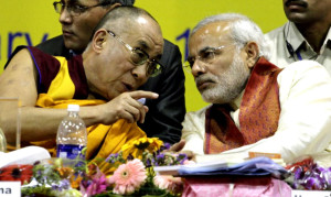 The Dalai Lama, left, speaks with Gujarat state Chief Minister Narendra Modi during an international seminar on Buddhist Heritage in Vadodara, south of Ahmadabad, India, Friday, Jan.15, 2010. The Dalai Lama inaugurated the three-day international seminar that began Friday.